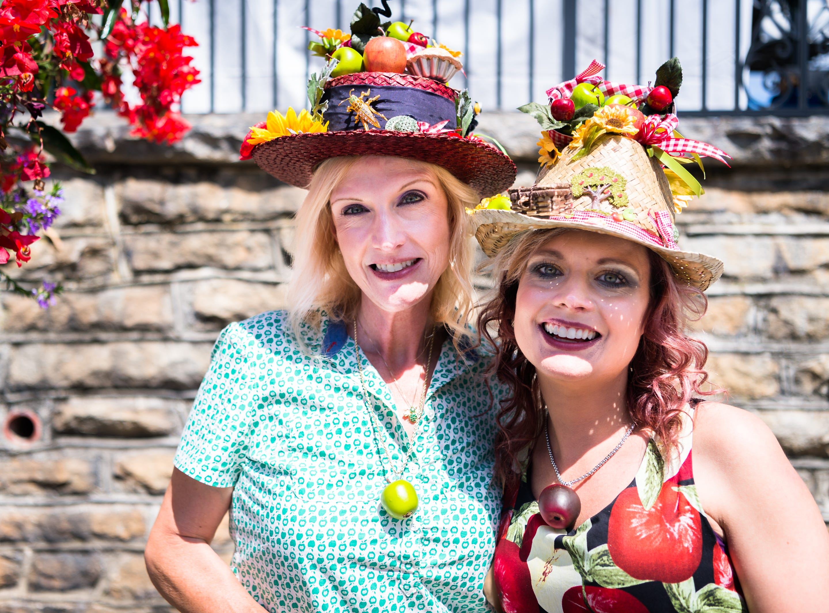 Laurlene Upton, and her daughter Linnea Puntigan, both of Spartanburg, SC, pose with hats made by Upton and festive attire at the 72nd annual North Carolina Apple Festival in Hendersonville Saturday, September 1, 2018.