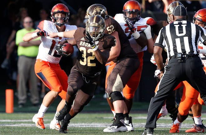 Western Michigan Broncos running back Jamauri Bogan (32) runs the ball during the first quarter against the Syracuse Orange at Waldo Stadium.