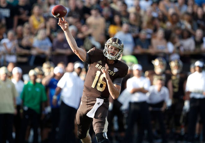 Western Michigan Broncos quarterback Jon Wassink (16) throws the ball during the first quarter against the Syracuse Orange at Waldo Stadium.