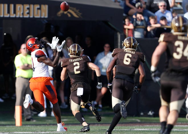 Syracuse Orange wide receiver Jamal Custis (17) makes a catch against Western Michigan Broncos defensive back Justin Tranquill (2) during the first quarter at Waldo Stadium.