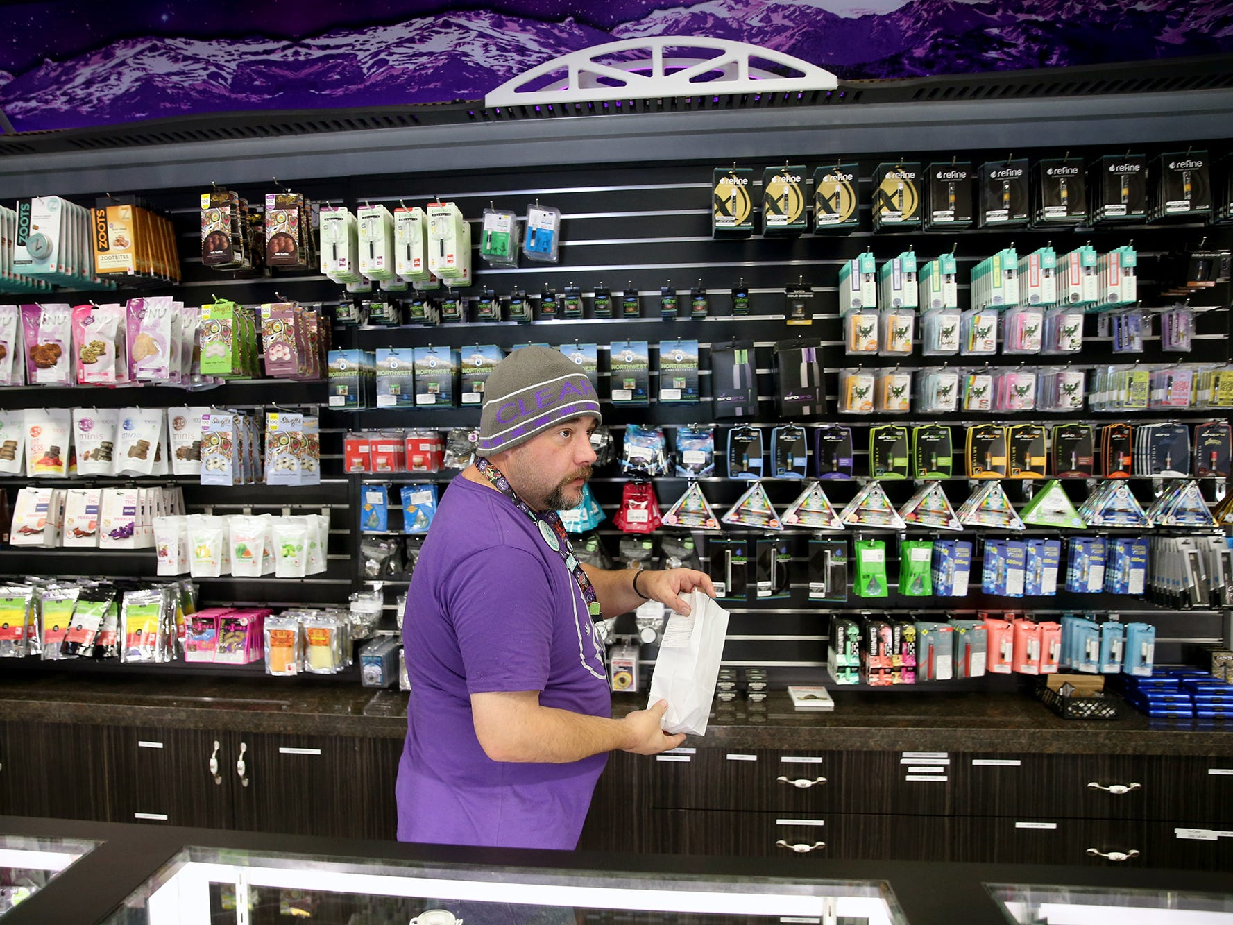Clear Choice Cannabis in East Bremerton on Highway 303 bud tender Luc Martin fills a customer's order on Monday, August 27, 2018.
