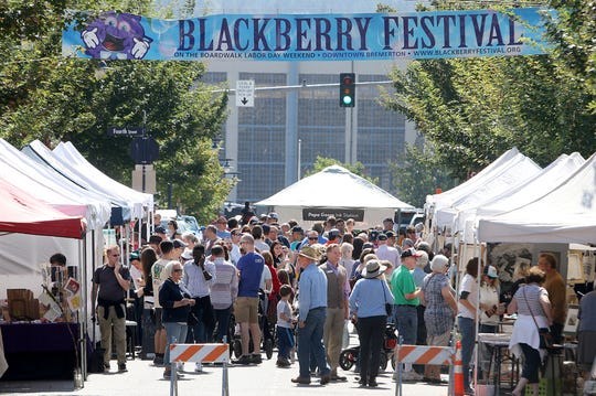 People flock to the Wayzgoose Arts Festival at Fourth Street and Pacific in downtown Bremerton on Saturday, September 1, 2018.