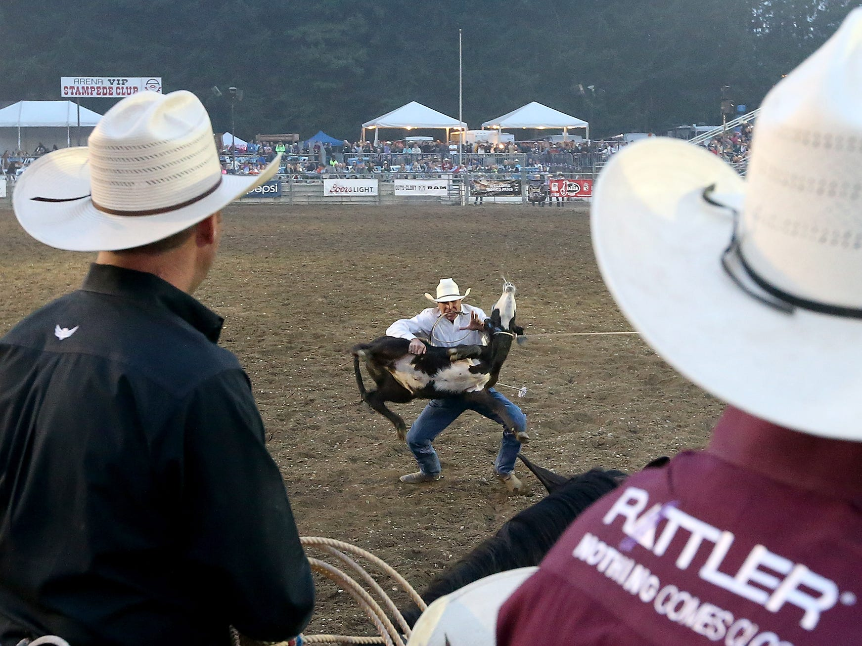 Seth Hopper, of Stanfield, OR, competes in the Tie Down Roping at the Kitsap County Fair & Stampede on Friday, August 24. 2018.