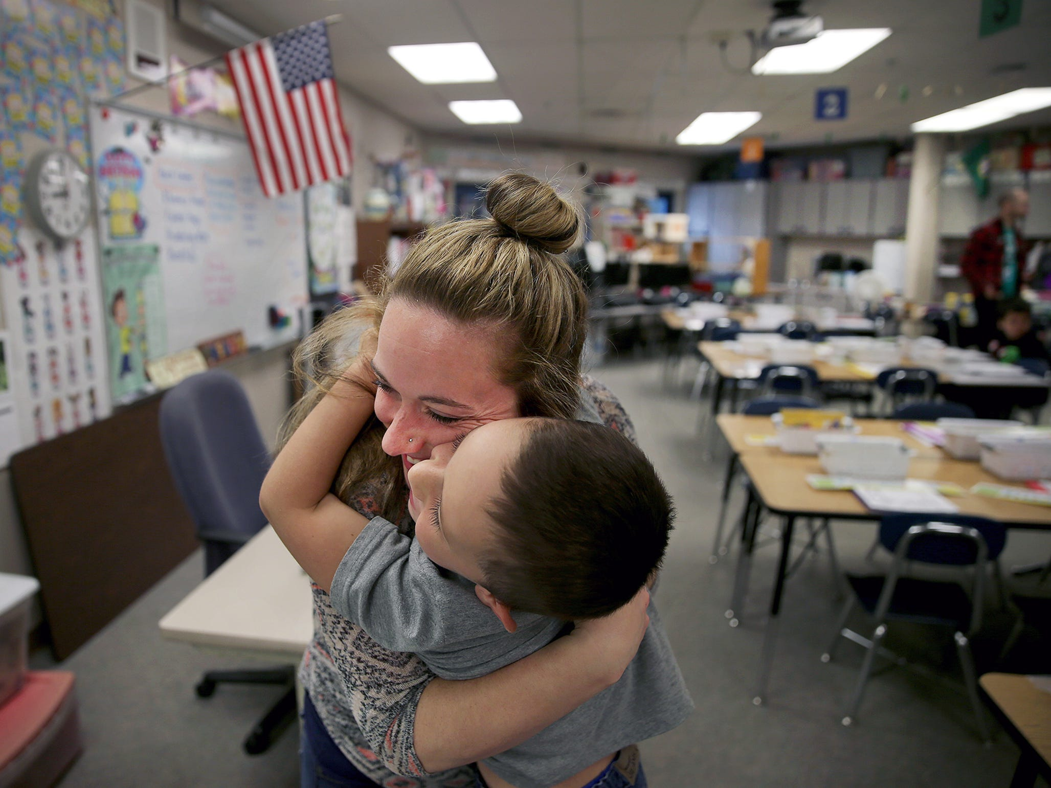 Amanda Rhea gives her son Carson, 6, a big hug as she leaves him in his first grade classroom for the first day of school at Kitsap Lake Elementary School on Wednesday, August 29, 2018.