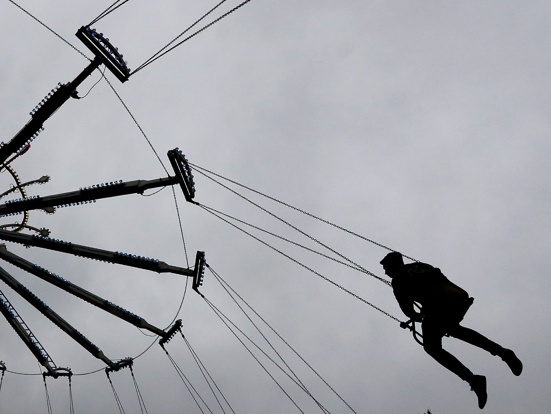 YoYo riders are silhouetted against the cloudy sky during the Kitsap County Fair & Stampede on Saturday, August 25. 2018.