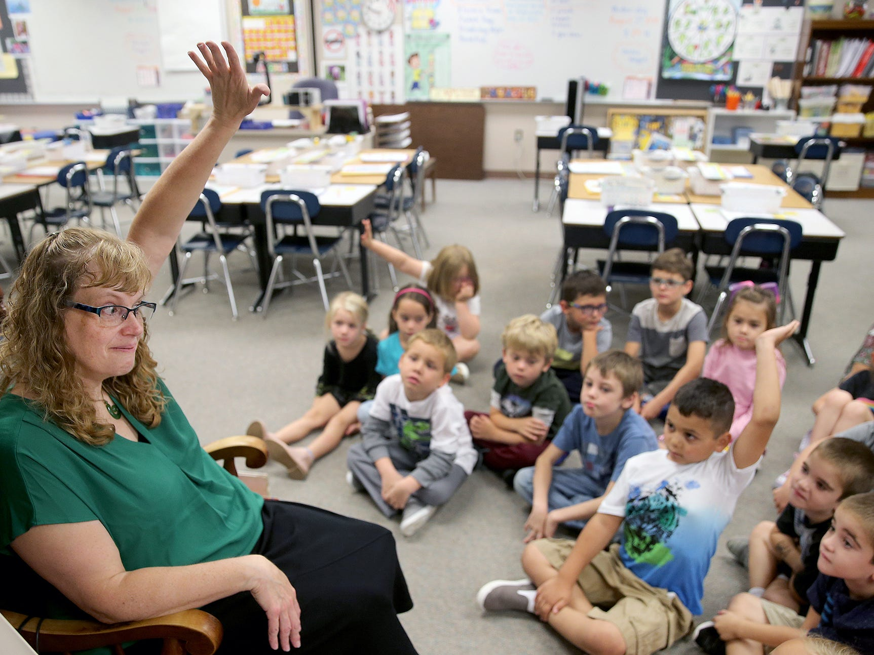 First grade teacher Becky Montgomery encourages students to raise their hands for questions during the first day of classes at Kitsap Lake Elementary School on Wednesday, August 29, 2018.