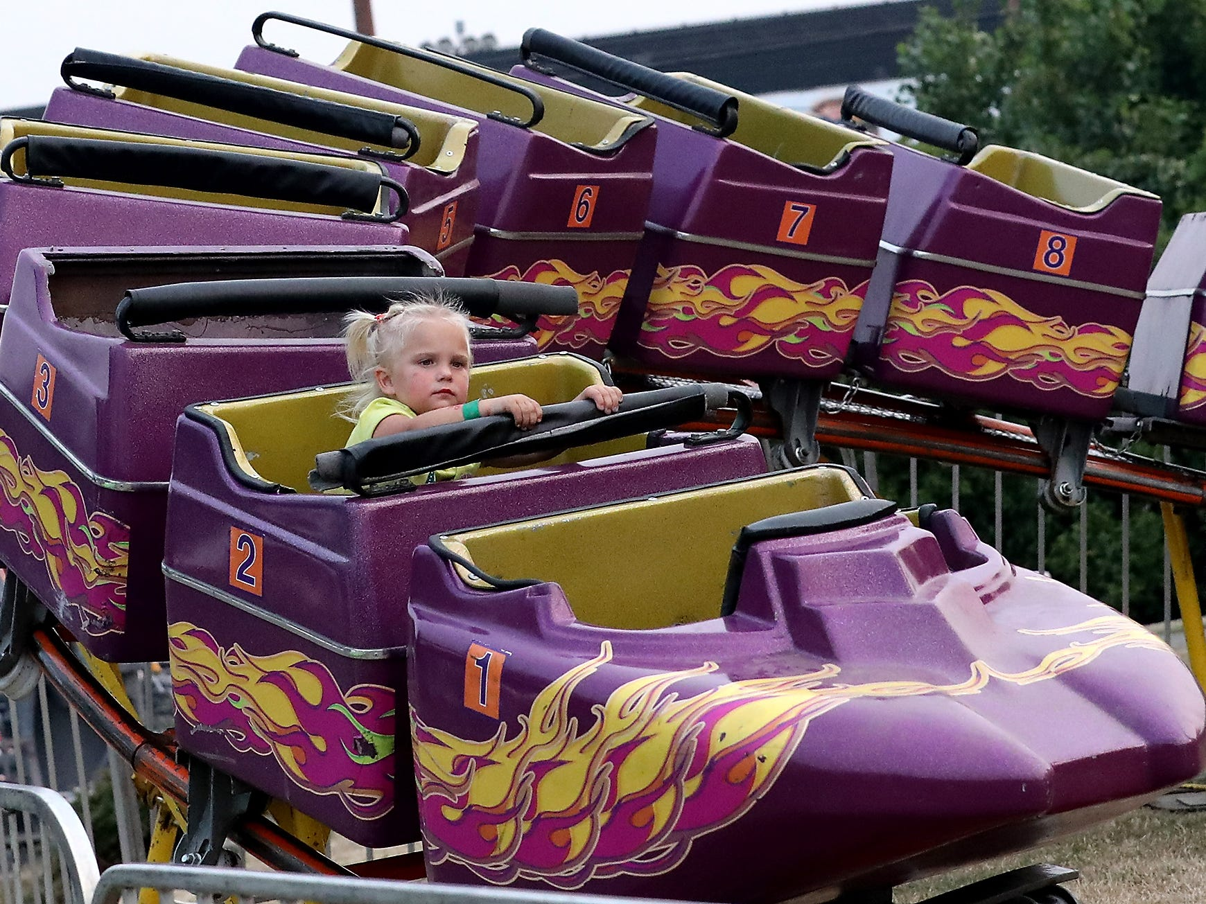 Belladonna Kindt, 3, gets a whole ride to her self during the opening day of the Kitsap County Fair & Stampede on Wednesday, August 22. 2018.