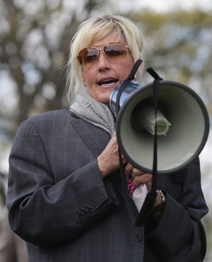 WASHINGTON, DC - APRIL 23:  Consumer advocate Erin Brockovich addresses a rally against the federal government's support for what they say is a known polluter on Capitol Hill April 23, 2014 in Washington, DC. Veterans, their families and environmental and consumer advocates rallied to protest the Department of Justice's support for electronic manufacturer CTS Corporation, the defendant in the U.S. Supreme Court case CTS Corportation v. Waldburger. It was revealed in the 1980s that Camp LeJeune had one of the most contaminated public drinking water supply ever discovered in the United States and now one of the biggest cluster of male breast cancer cases ever identified.  (Photo by Chip Somodevilla/Getty Images)