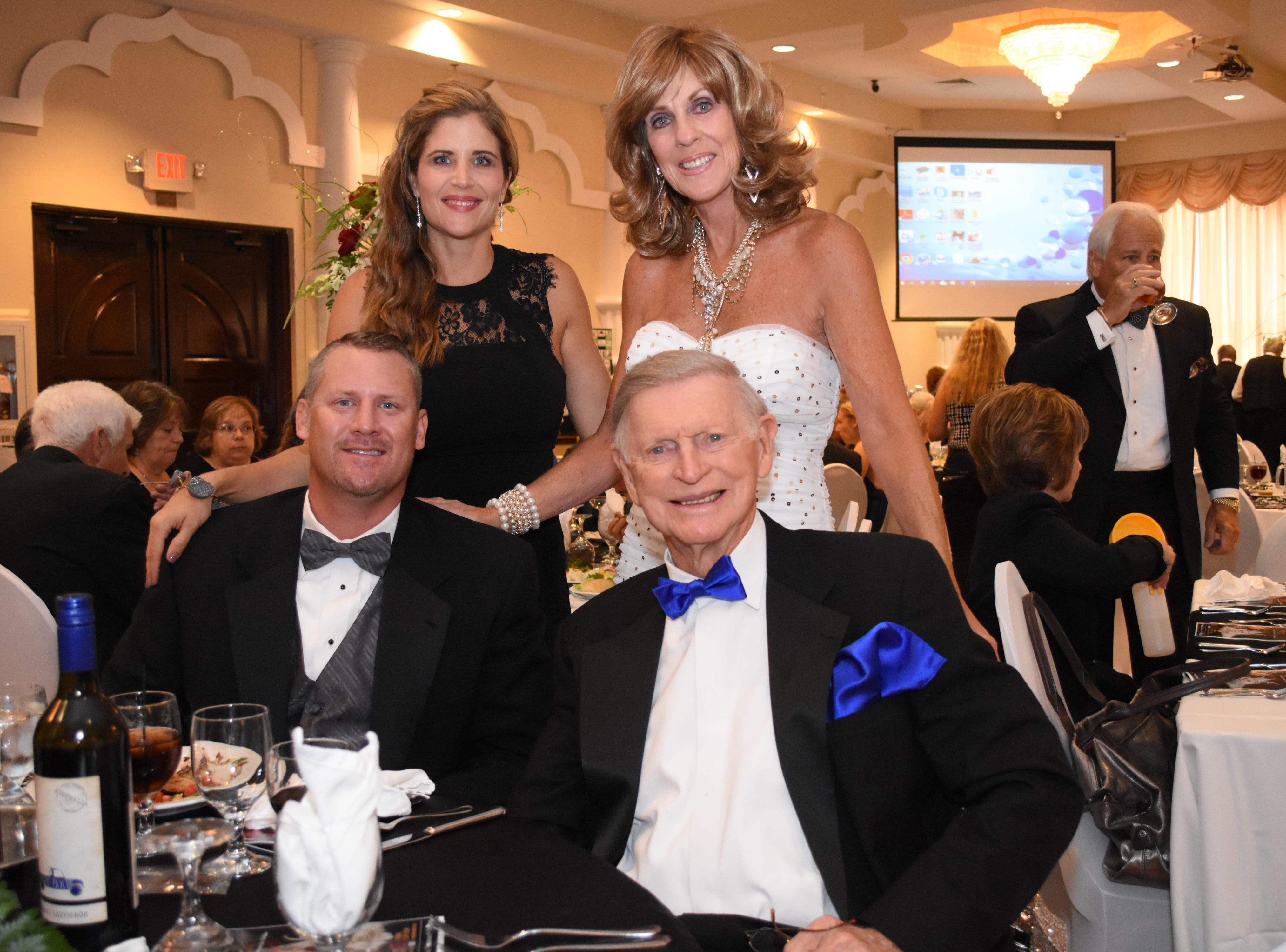 Tom, Drew, Susie, and Lindsey Wasdin pose for a photo. Susie and Tom are Brevard 2018 Tuxes and Tails honorary hosts.