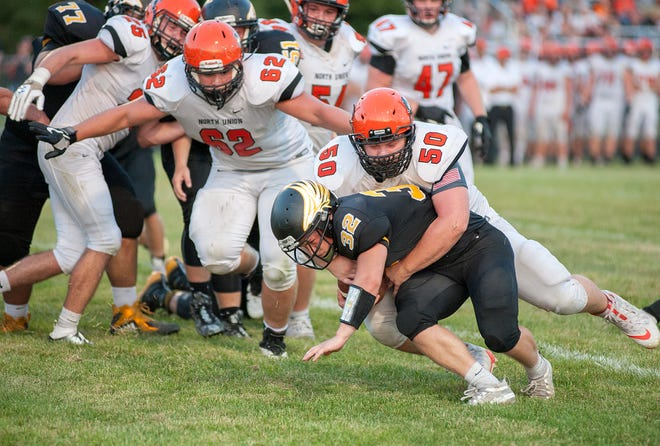 North Union's Dylan Thompson wraps up Colonel Crawford's Dylan Knisely.