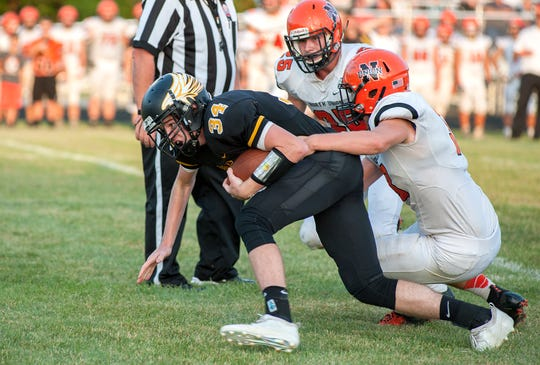 Colonel Crawford's Chase Walker is slowed down by the North Union defense.