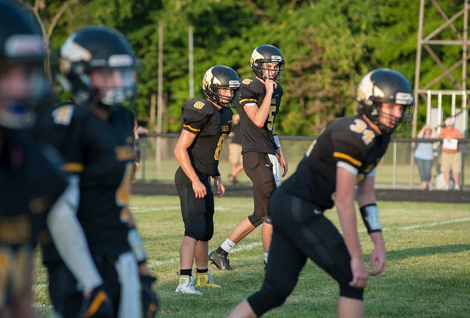 Colonel Crawford's offense lines up before the snap against North Union.