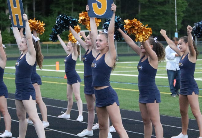 The Essex cheer team fires up a huge crowd at Munson Field in South Burlington on Friday night. The game featured the Essex Hornets and the newly formed co-op team from Burlington and South Burlington.