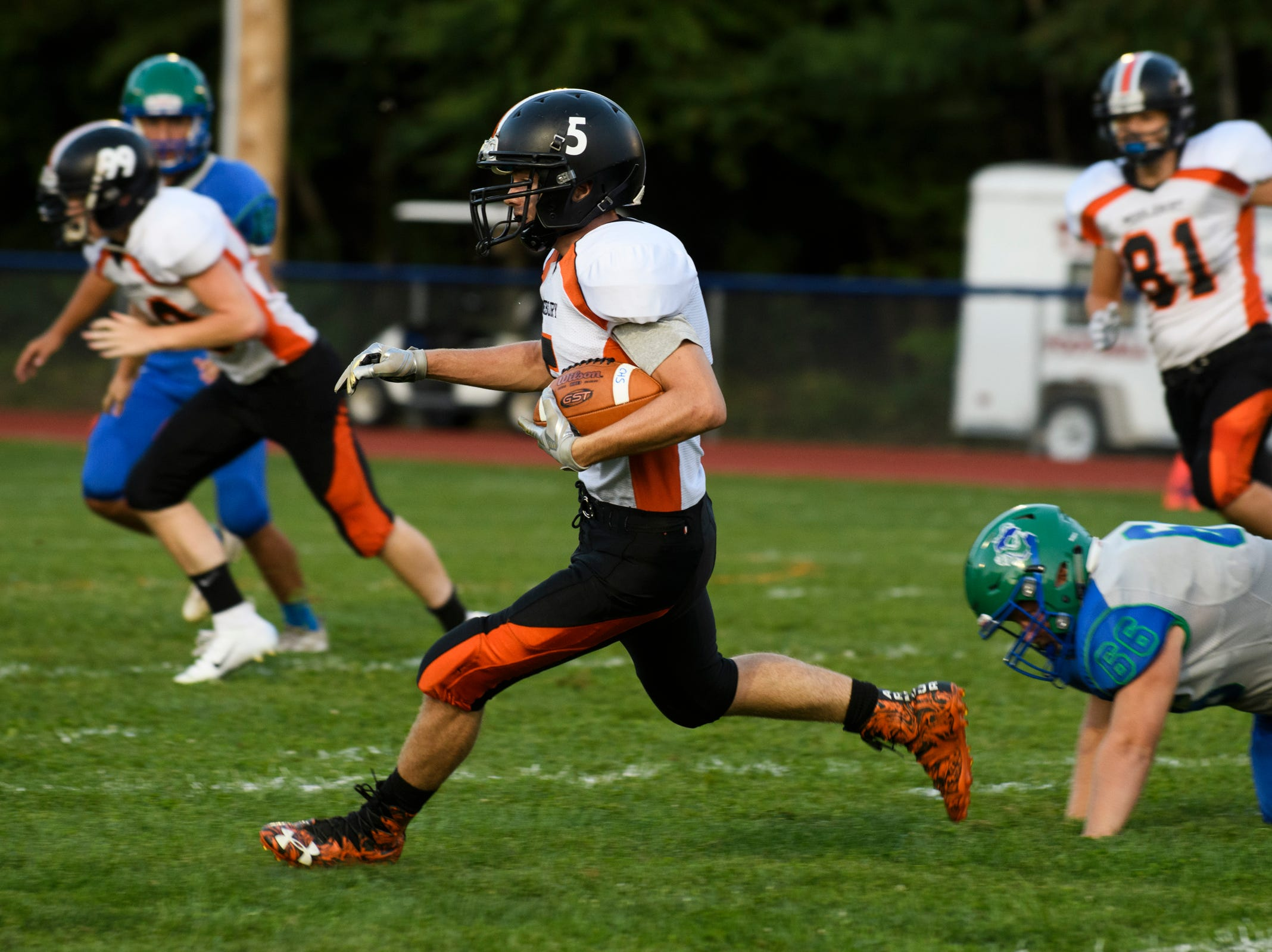 Middlebury's Ian Ploof (5) returns the kick off for a touchdown during the boys high school football game between Middlebury and Colchester at Colchester high school on Friday night August 31, 2018 in Colchester.