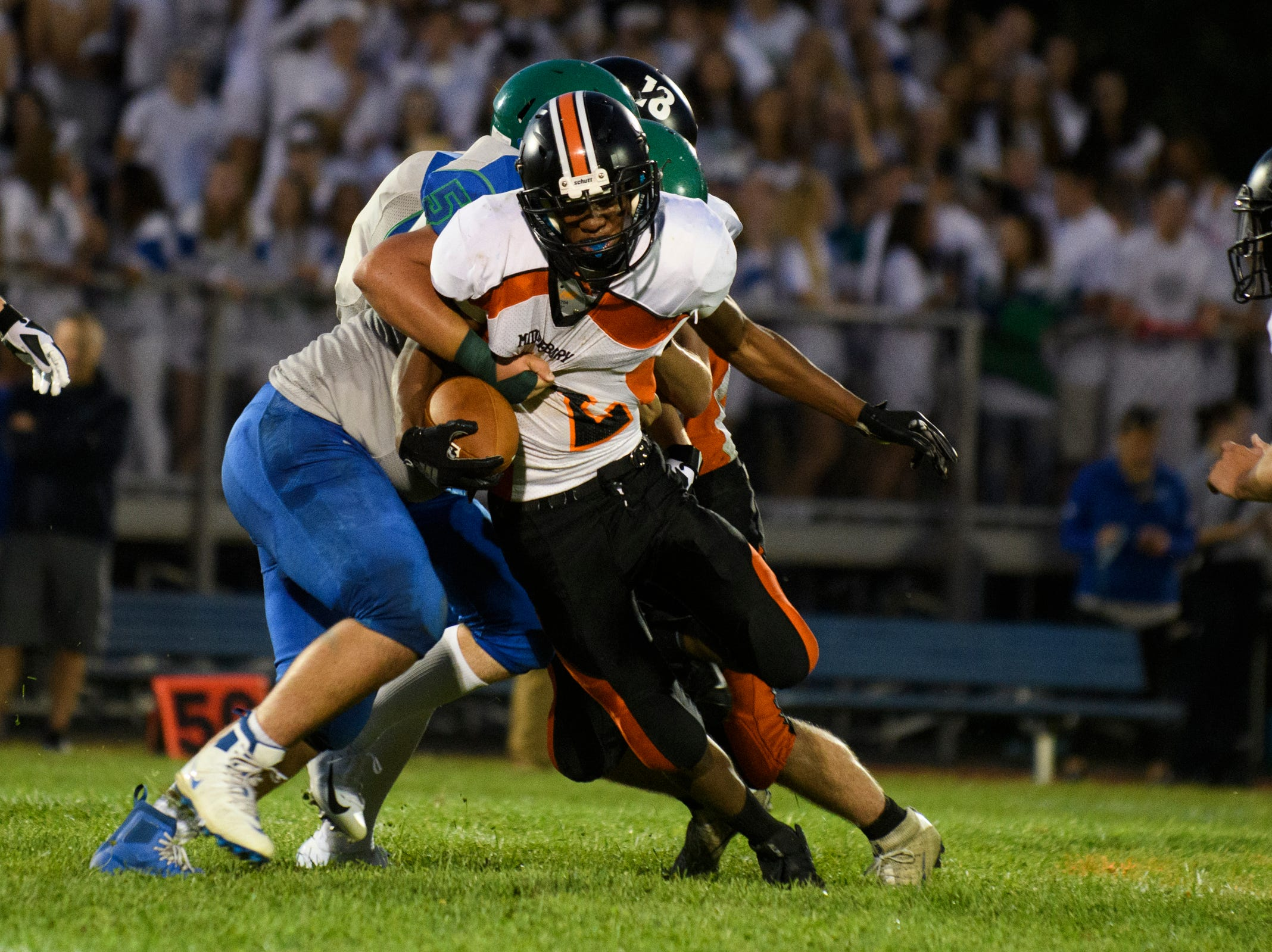 Middlebury's CJ Bryant (2) runs with the football during the boys high school football game between Middlebury and Colchester at Colchester high school on Friday night August 31, 2018 in Colchester.