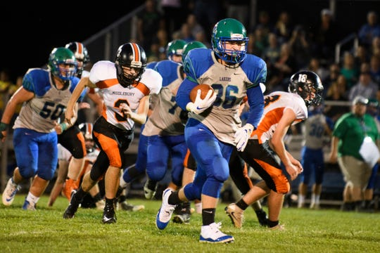 Colchester's Charlie Cusson-Ducharme (36) runs with the ball for a touchdown during the boys high school football game between Middlebury and Colchester at Colchester high school on Friday night August 31, 2018 in Colchester.
