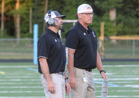 SeaWolves head coach Joe McDonald (right) and offensive coordinator Brennan Carney keep an eye on things during their team's season-opening win over Essex last weekend.