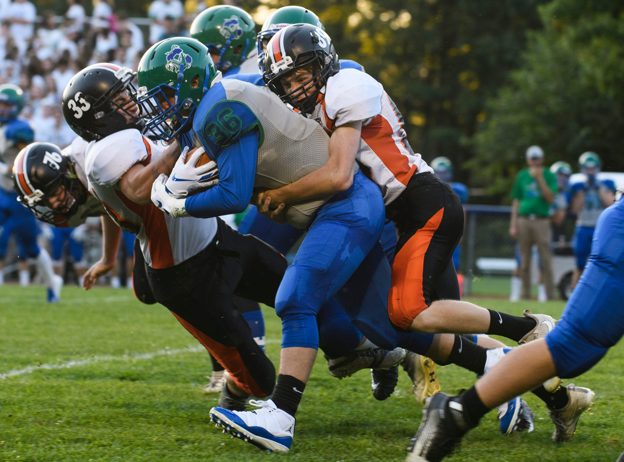 Middlebury's Wyatt Cameron (89) tackles Colchester s Charlie Cusson-Ducharme (36) during the boys high school football game between Middlebury and Colchester at Colchester high school on Friday night August 31, 2018 in Colchester.