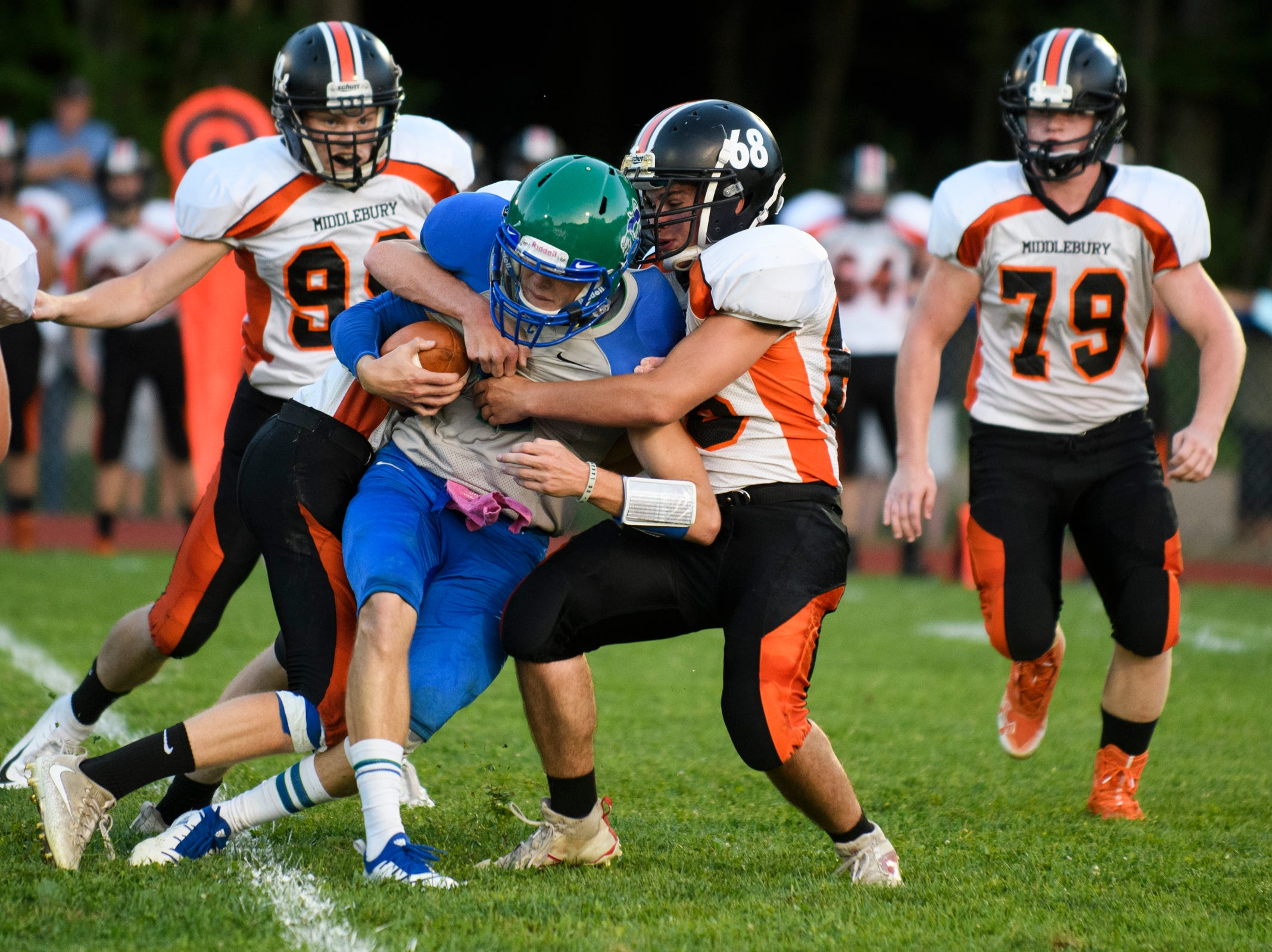 Middlebury's Trysten Quesnel (68) tackles Colchester's Bailey Olson (11)during the boys high school football game between Middlebury and Colchester at Colchester high school on Friday night August 31, 2018 in Colchester.