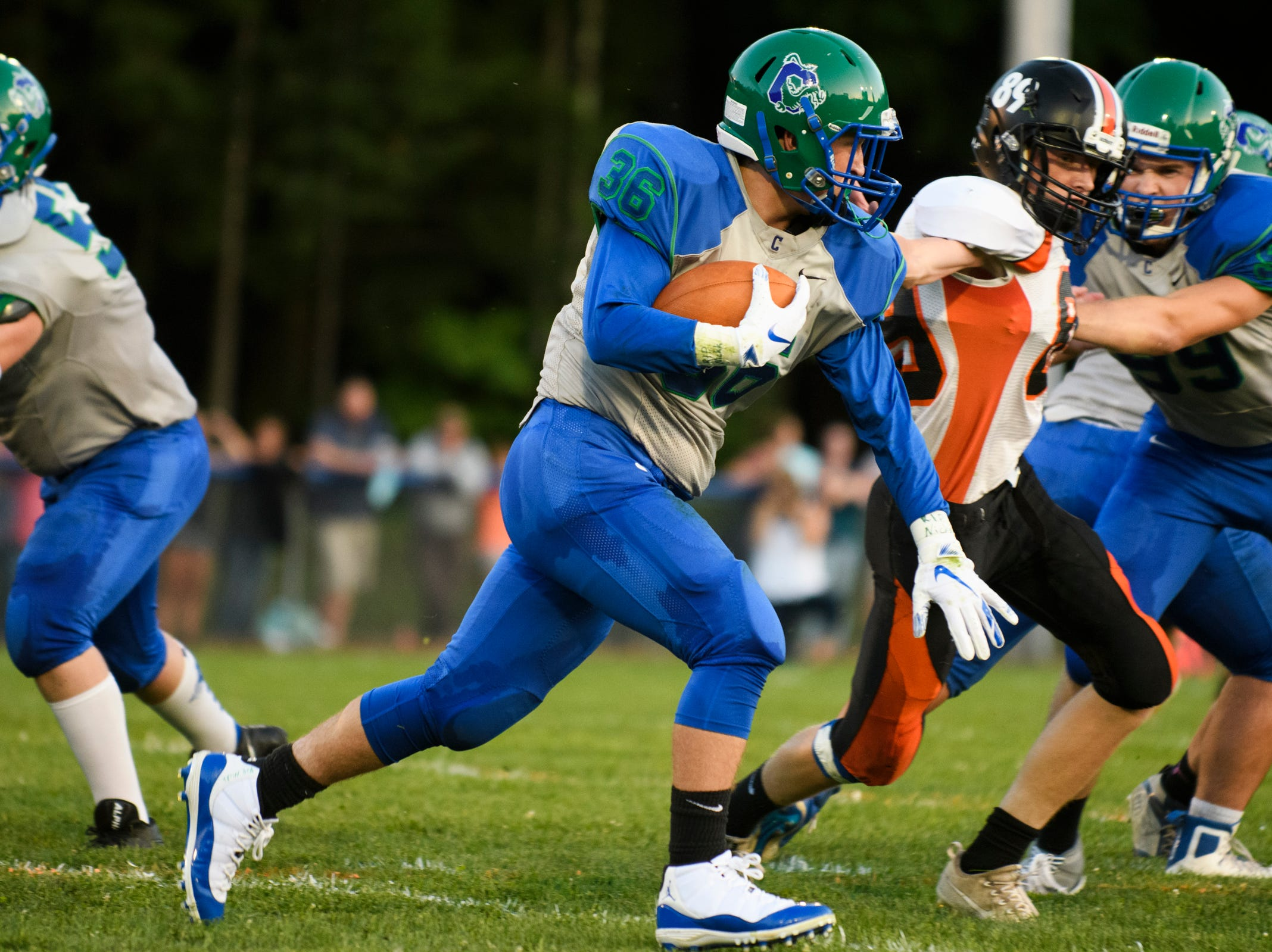 Colchester's Charlie Cusson-Dusharme (36) runs with the ball during the boys high school football game between Middlebury and Colchester at Colchester high school on Friday night August 31, 2018 in Colchester. (BRIAN JENKINS/for the FRESS PRESS)
