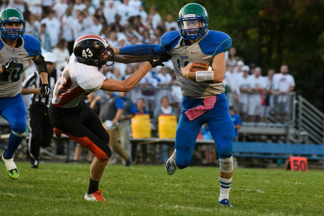 Middlebury's Mason Kauffman (43) tries to tackle Colchester's Bailey Olson (11) during the boys high school football game between Middlebury and Colchester at Colchester high school on Friday night August 31, 2018 in Colchester.