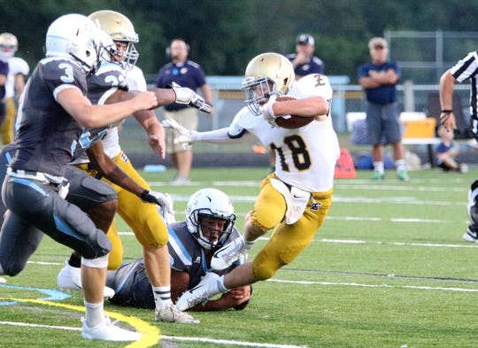 Essex QB Luke Williams eludes the grasp of the Seawolves pass rush during a 21-0 season opening loss.