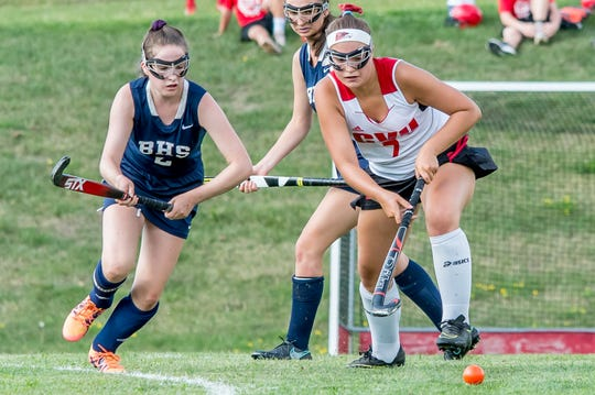 Burlington's captain, Isa Bloch races for possession with CVU's Flynn Hall at Friday's field hockey in Hinesburg.