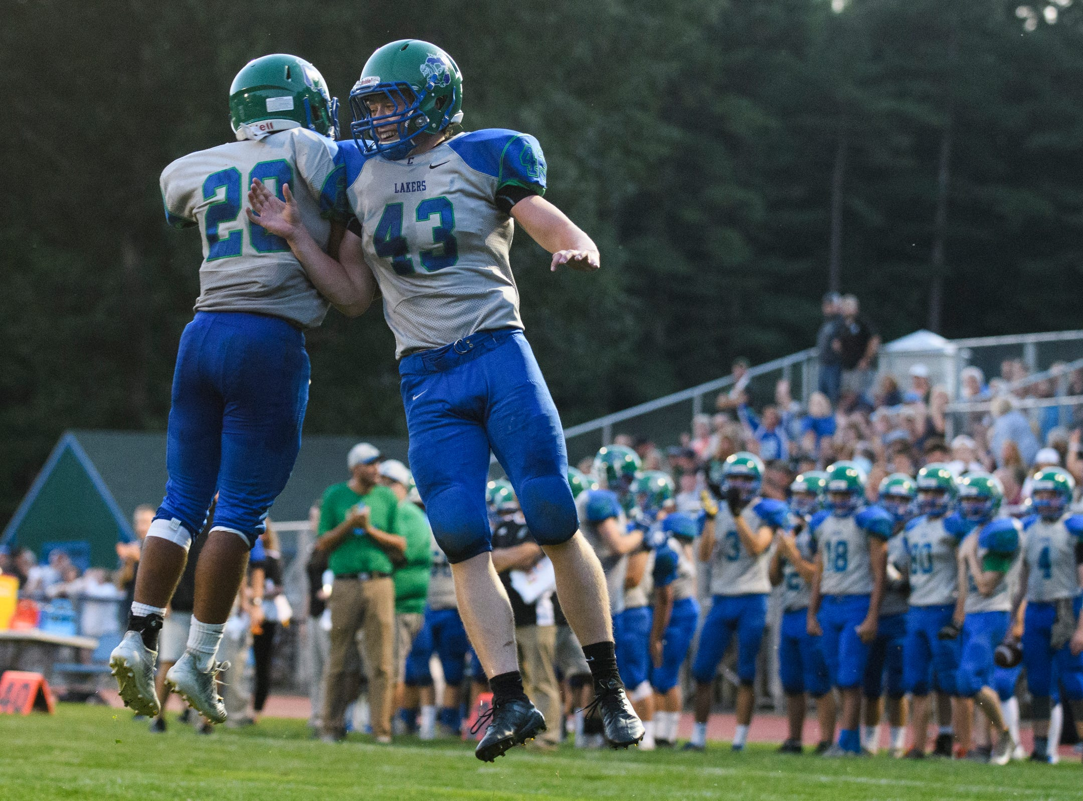 Colchester's Max Anderson (43) and Brod Stannard (20) celebrate a touchdown during the boys high school football game between Middlebury and Colchester at Colchester high school on Friday night August 31, 2018 in Colchester.