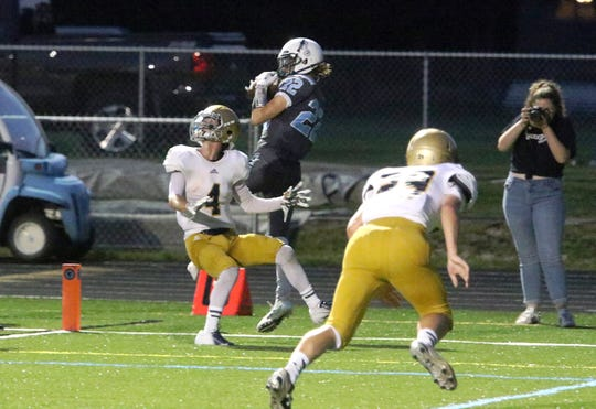 Chance O'Conner of South Burlington scores the first ever touchdown for the Burlington-South Burlington SeaWolves co-op team. Fittingly the pass was thrown by BHS's Duncan McDonald. The SeaWolves went on to defeat Essex 21-0.