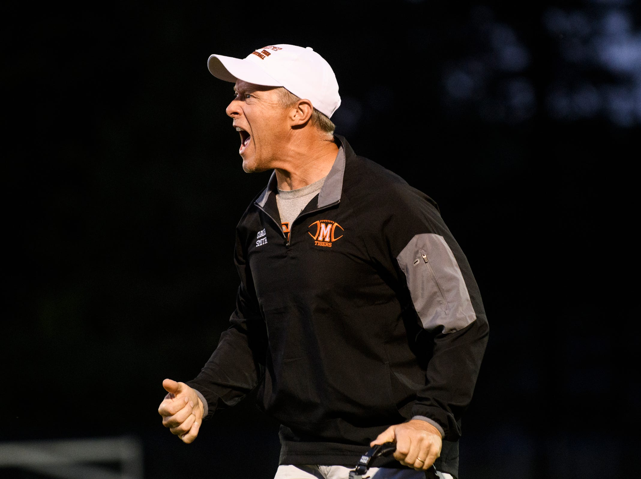 Middlebury head coach Dennis Smith yells to the players on the field during the boys high school football game between Middlebury and Colchester at Colchester high school on Friday night August 31, 2018 in Colchester.