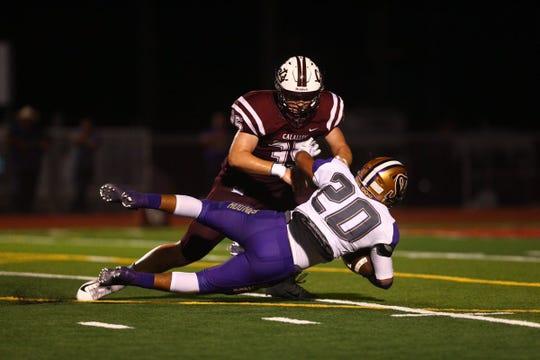 Calallen Wildcats battle the San Benito Greyhounds during the high school football season opener at Wildcat Stadium in Calallen.