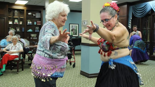 Sisters of the Dance Karen Escarzaga dances with Dee Bartolez at Trinity Towers Living Center Friday, Aug. 31.