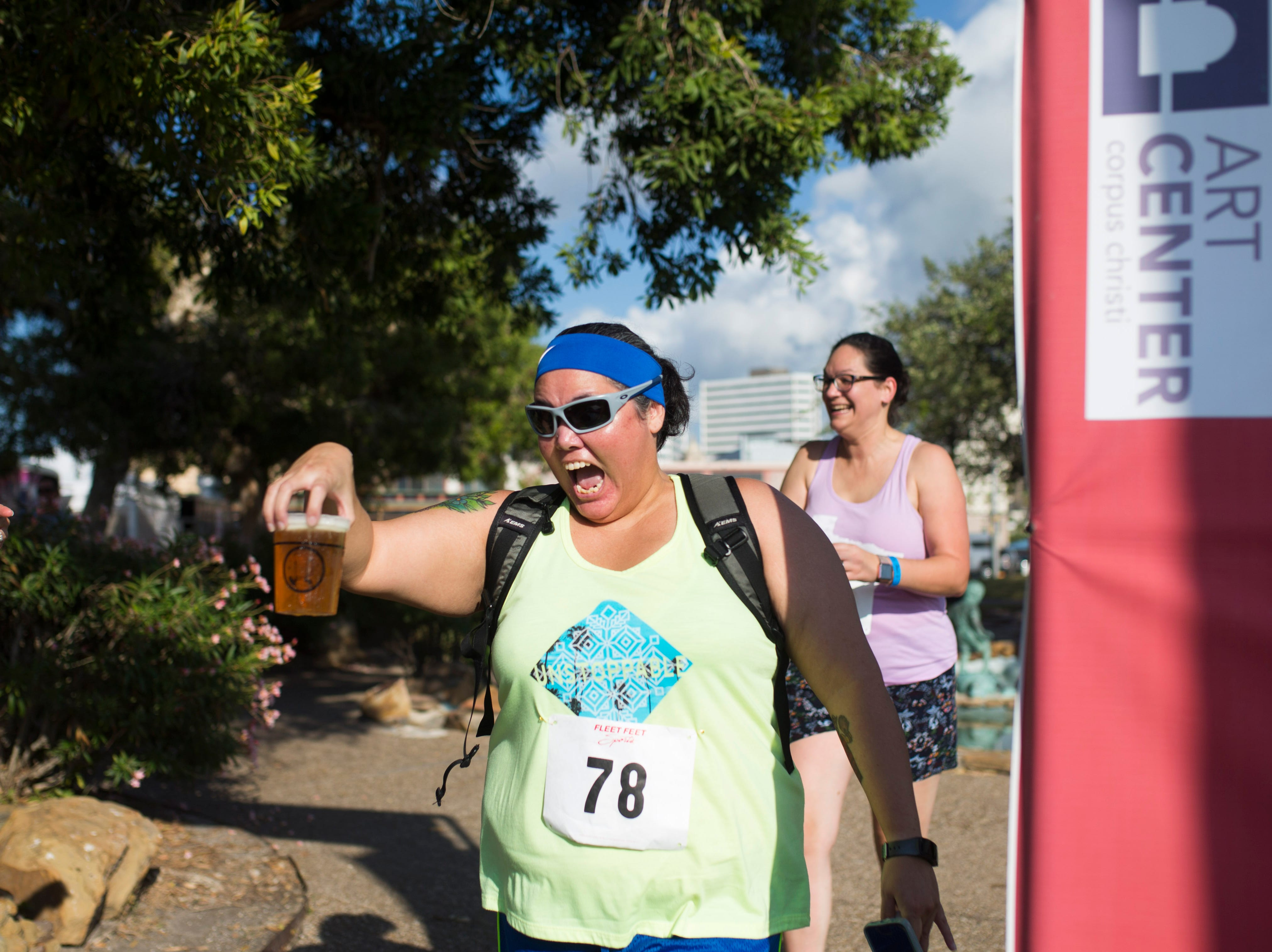 """Angelica """"yogi"""" Orr finishes in the 1/2 K By the Bay Beer Run during the annual Arts Alive Festival at the Art Center of Corpus Christi on Saturday, Sep. 1, 2018."""