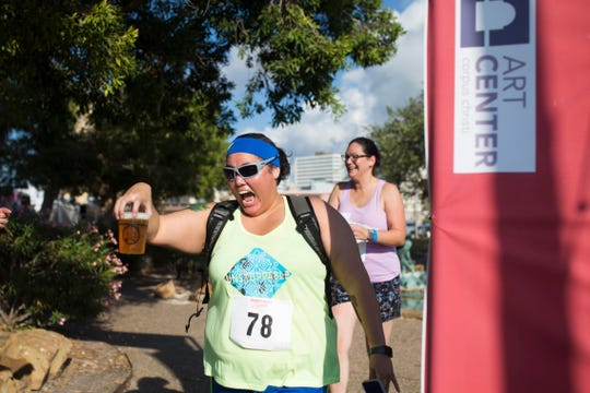 "Angelica ""yogi"" Orr finishes in the 1/2 K By the Bay Beer Run during the annual Arts Alive Festival at the Art Center of Corpus Christi on Saturday, Sep. 1, 2018."