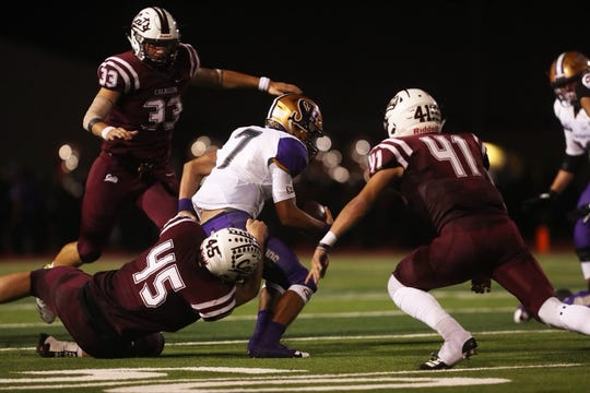 Calallen defenders swarm a San Benito rusher during the high school football season opener at Wildcat Stadium in Calallen.