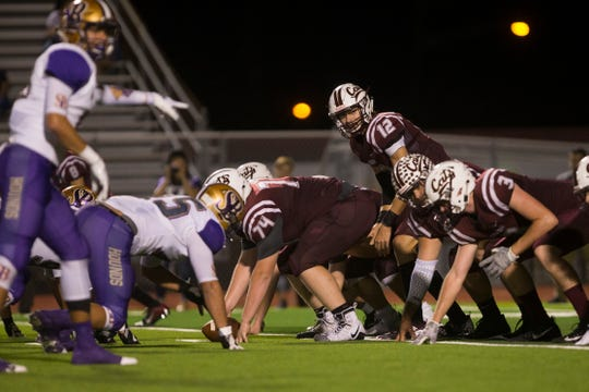 Calallen Wildcats battle the San Benito Greyhounds during their high school football season opener at Wildcat Stadium in Calallen