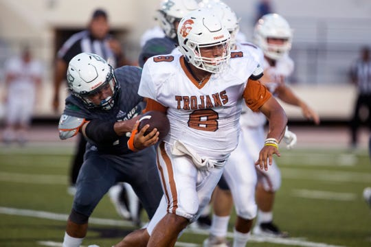 Beeville Trojans quarterback Seth Gomez breaks away for a quarterback keep in the first quarter of the game against the King Mustangs at Buccaneer Stadium on Friday, August 31, 2018.