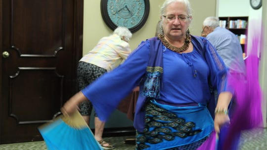 Sisters of the Dance Kandy Wheeler performs a belly dancing solo at Trinity Towers Senior Living Center Friday, Aug. 31.