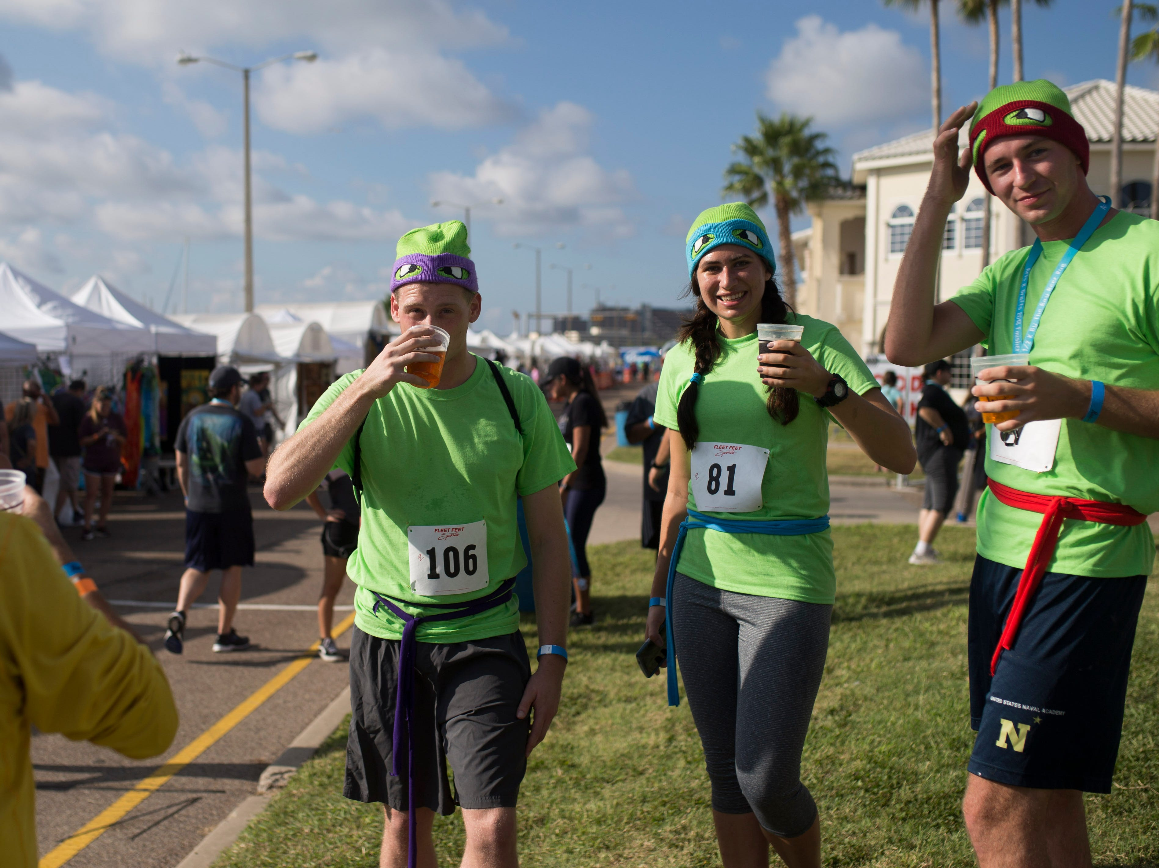 Cooper Wood, Laura Black, and John Holland enjoy their beers after competing in the 1/2 K By the Bay Beer Run during the annual Arts Alive Festival at the Art Center of Corpus Christi on Saturday, Sep. 1, 2018.