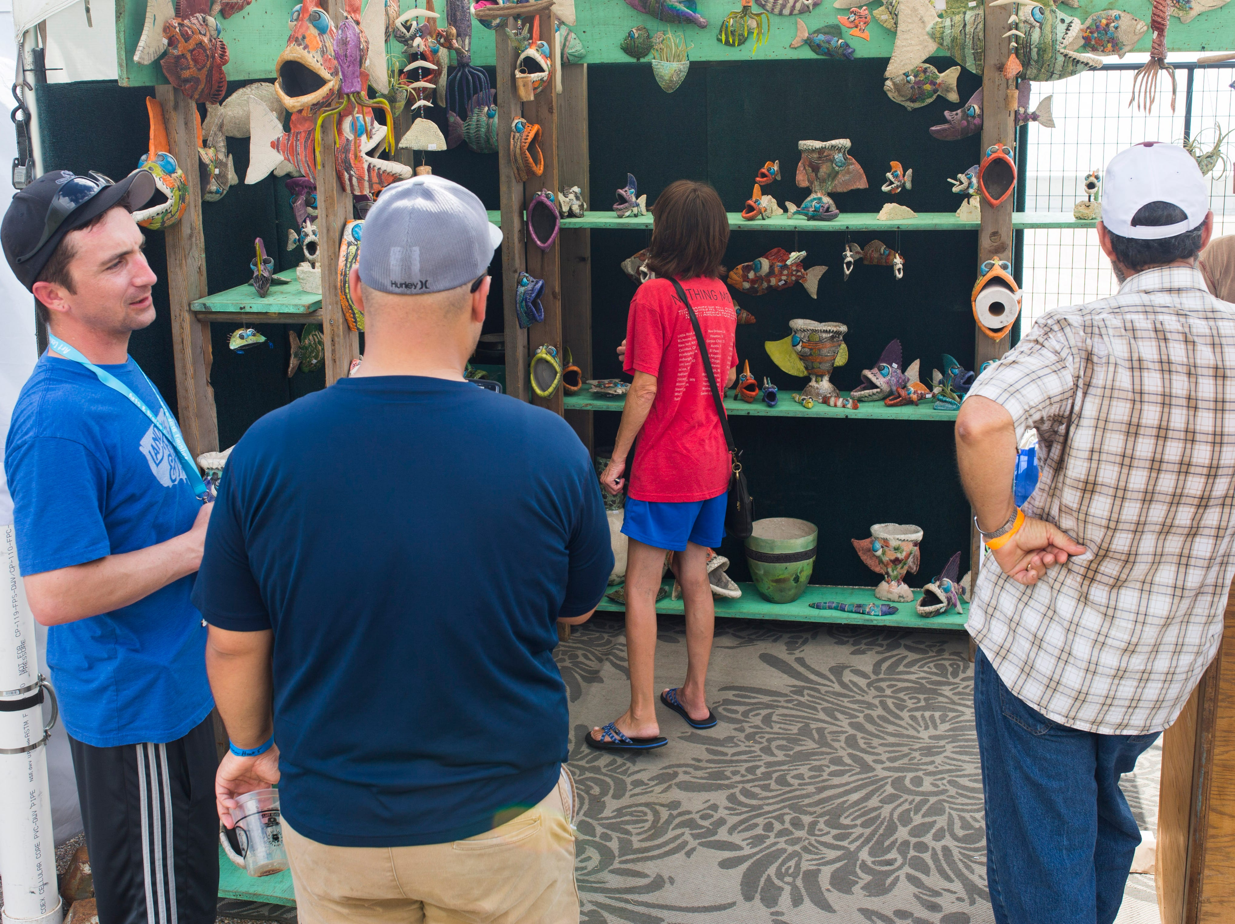 People shop during the annual Arts Alive Festival at the Art Center of Corpus Christi on Saturday, Sep. 1, 2018.