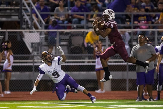 Calallen's Shenan Price catch over a San Benito defender during their game on Friday, Aug. 31, 2018 at Wildcat Stadium in Calallen