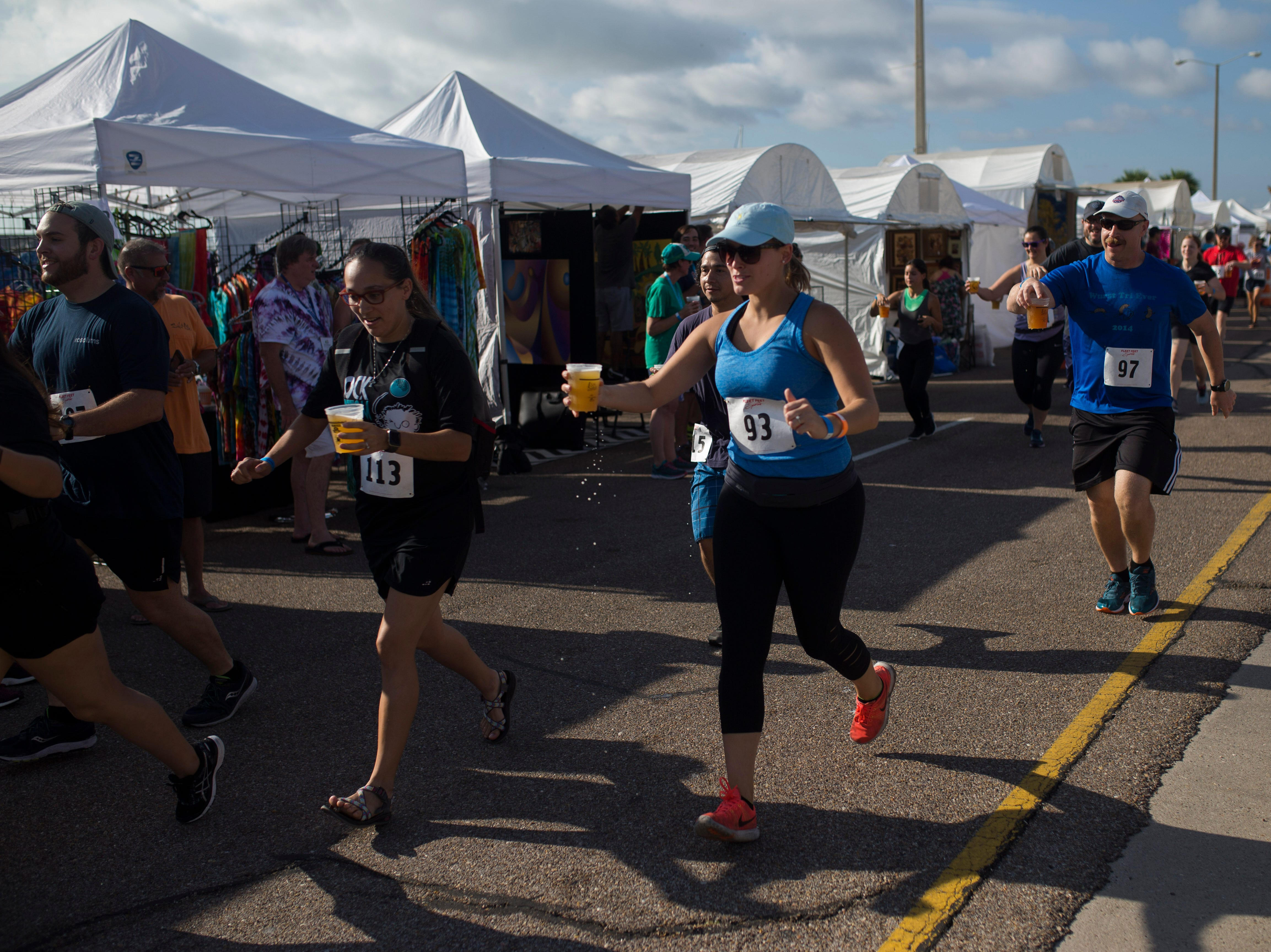 Runner compete in the 1/2 K By the Bay Beer Run during the annual Arts Alive Festival at the Art Center of Corpus Christi on Saturday, Sep. 1, 2018.