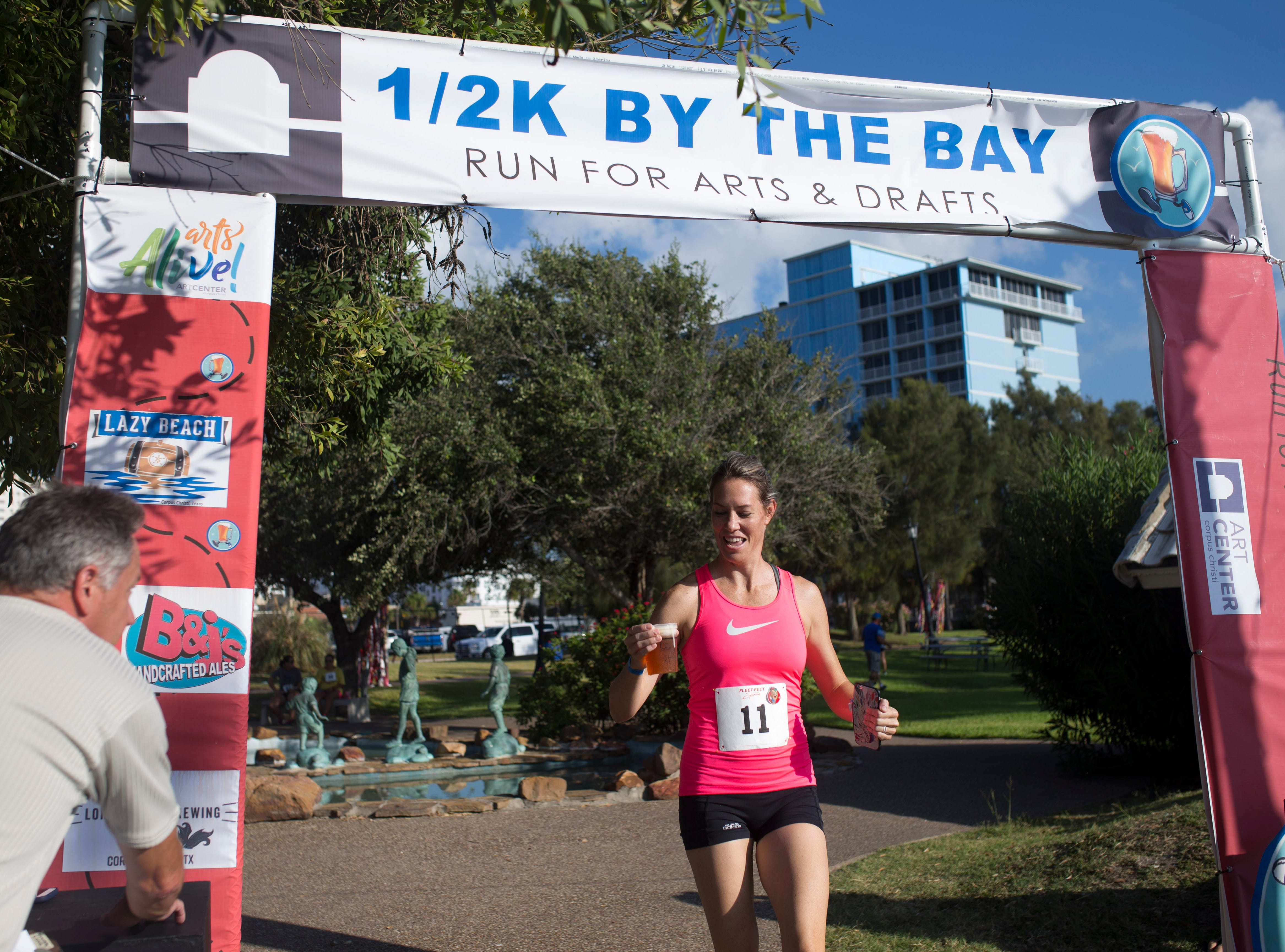 Ashley Pettus finish first in her heat for the 1/2 K By the Bay Beer Run's  during the annual Arts Alive Festival at the Art Center of Corpus Christi on Saturday, Sep. 1, 2018.