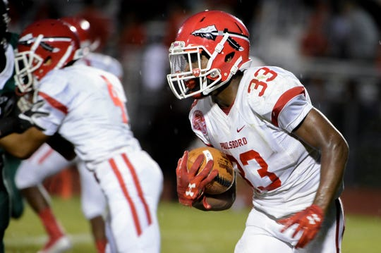 Paulsboro's Bhayshul Tuten (33) carries the ball against West Deptford Friday, Aug. 31, 2018 at West Deptford High School in West Deptford, N.J. Paulsboro won 19-14.