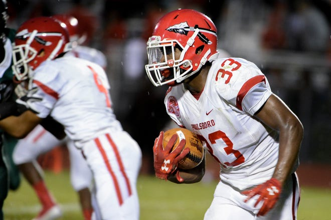 Paulsboro's Bhayshul Tuten (33) carries the ball against West Deptford earlier this season.