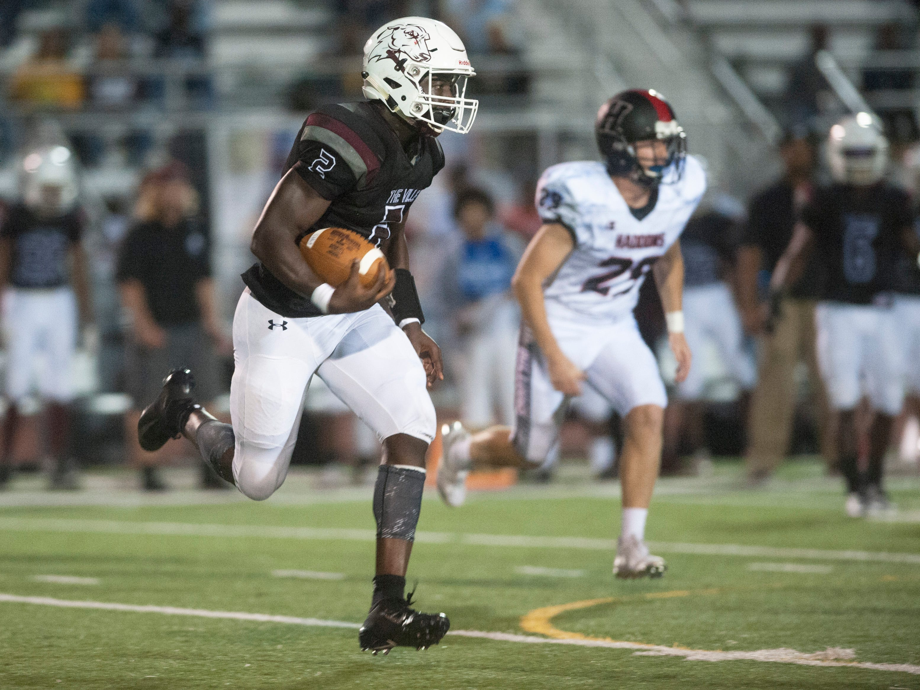 Pleasantville's Mohamed Toure runs the ball during the 2nd quarter of Friday night's football game between Haddonfield and Pleasantville, played at Pleasantville High School on August 31, 2018.