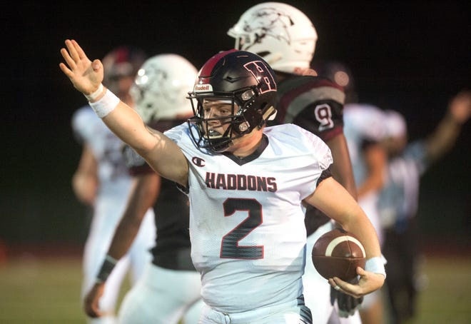 Haddonfield's Jay Foley celebrates after running the ball for a 1st down during the 2nd quarter of Friday night's football game between Haddonfield and Pleasantville, played at Pleasantville High School on August 31, 2018.