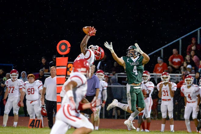 Paulsboro's Bhayshul Tuten (top left) intercepts a ball intended for West Deptford's Ken Lim during the Red Raiders' 19-14 win on Aug. 31. The two teams moved their annual Thanksgiving clash to Week 0 this year and it reinvigorated the rivalry.