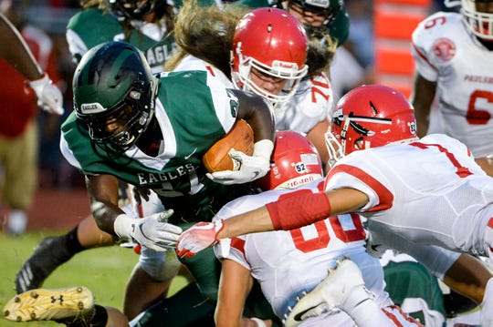 West Deptford's Tyshawn Bookman (27) rushes against Paulsboro Friday, Aug. 31, 2018 at West Deptford High School in West Deptford, N.J.