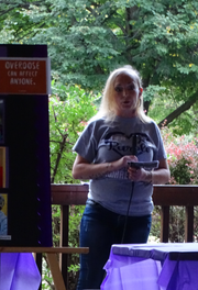 Jazzy Babineau tells her story of addiction to an audience of over 100 people at Friday's Overdose Awareness Day in Yoctangee Park.